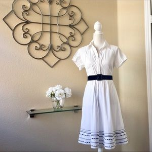 Crisp white dress w/ patterned embroidered trim
